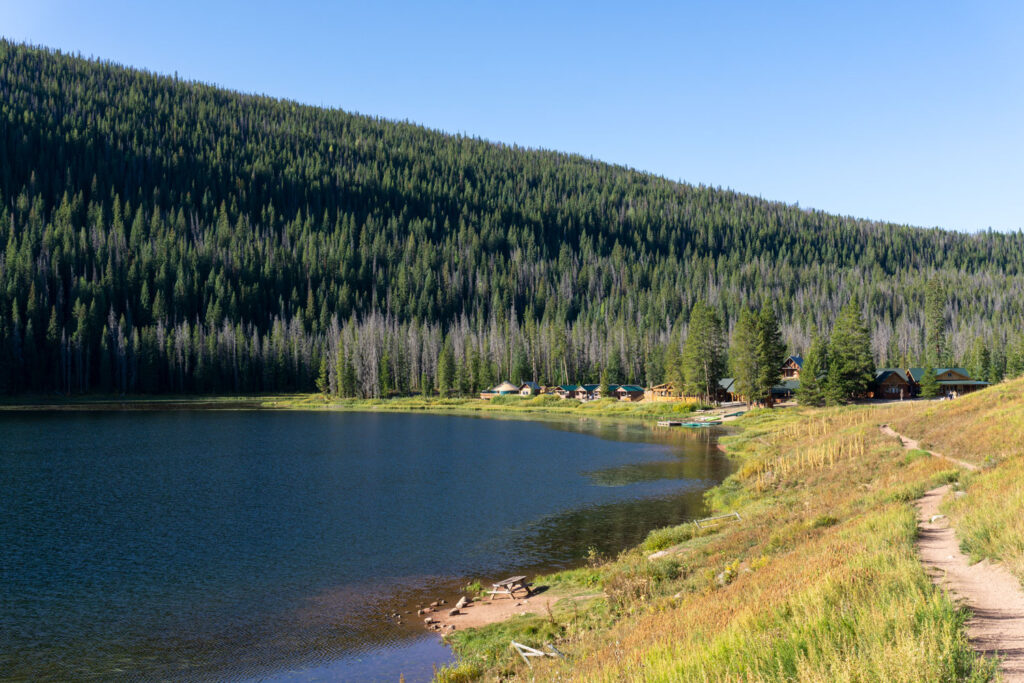 Pet friendly cabins line the shore of  Piney Lake in Colorado